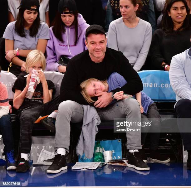 Alexander Schreiber Liev Schreiber and Samuel Schreiber attend the Orlando Magic Vs New York Knicks game at Madison Square Garden on December 3 2017...