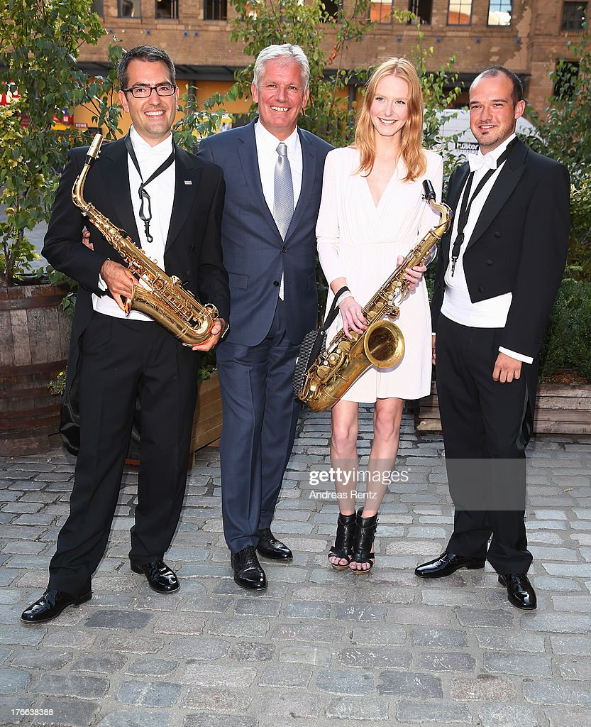 Alexander Schuhmacher (Head of Sales Region East, Audi) and Maike van Grieken with musicians attend the 12th Audi Classic Open Air during the AUDI Sommernacht at Kulturbrauerei on August 16, 2013 in Berlin, Germany.