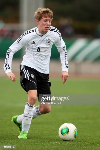 Alexander Schulte of Germany runs with the ball during the U15 international friendly match between Germany and South Korea at Jahnstadion on...