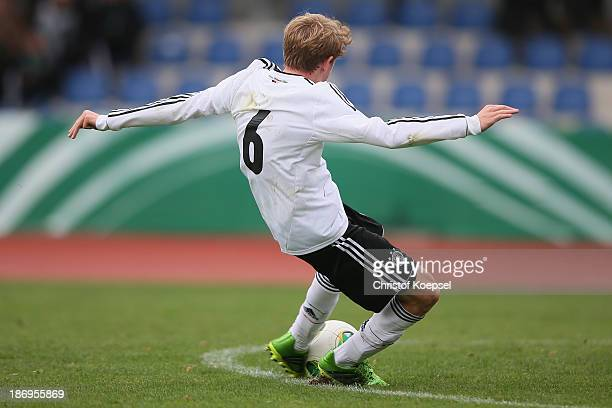 Alexander Schulte of Germany shoots the first goal during the U15 international friendly match between Germany and South Korea at Jahnstadion on...