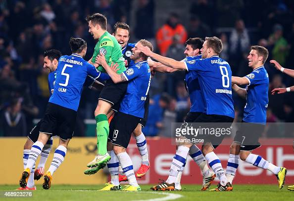 Alexander Schwolow goalkeeper of Bielefeld celebrate with his team mates after winning the DFB Cup Quarter Final match between Arminia Bielefeld and...