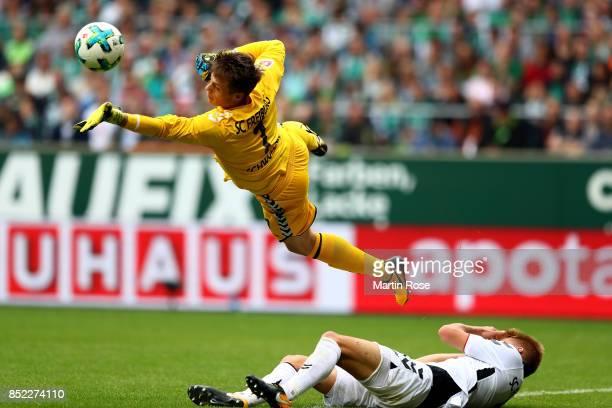 Alexander Schwolow goalkeeper of Freiburg makes a save during the Bundesliga match between SV Werder Bremen and SportClub Freiburg at Weserstadion on...