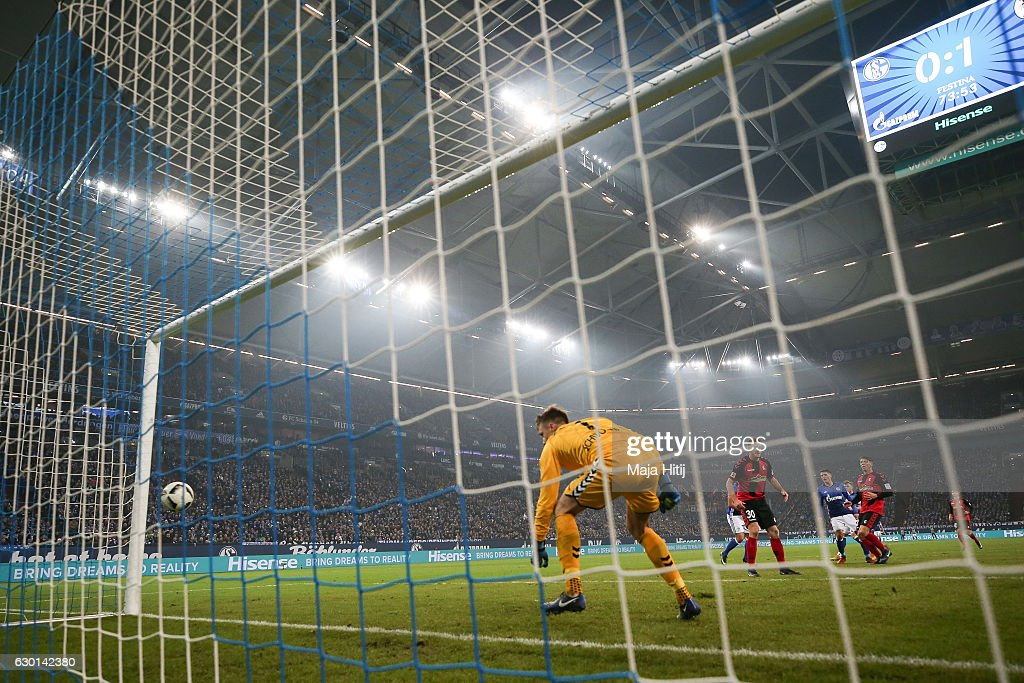 Alexander Schwolow (C) goalkeeper of Freiburg tries to save the equalizing goal of Yevhen Konoplyanka (not seen) of Schalke to make it 1-1 during the Bundesliga match between FC Schalke 04 and SC Freiburg at Veltins-Arena on December 17, 2016 in Gelsenkirchen, Germany.