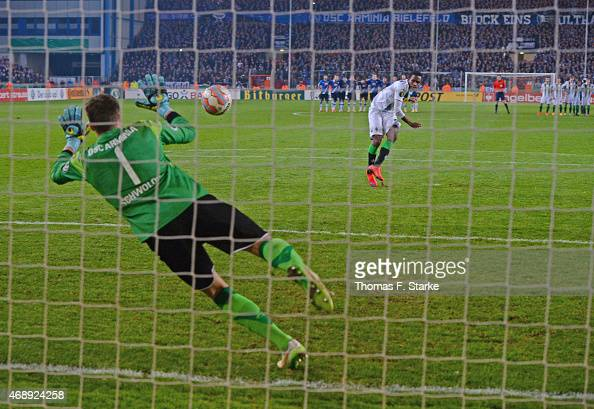 Alexander Schwolow of Bielefeld saves the final penalty by Ibrahima Traore of Moenchengladbach during the DFB Cup match between Arminia Bielefeld and...