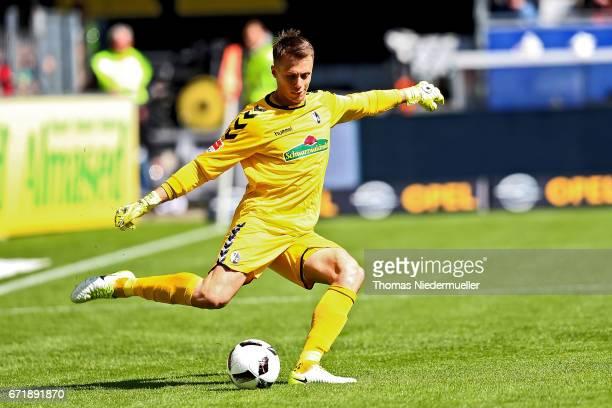 Alexander Schwolow of Freiburg in action with the ball during the Bundesliga match between SC Freiburg and Bayer 04 Leverkusen at SchwarzwaldStadion...