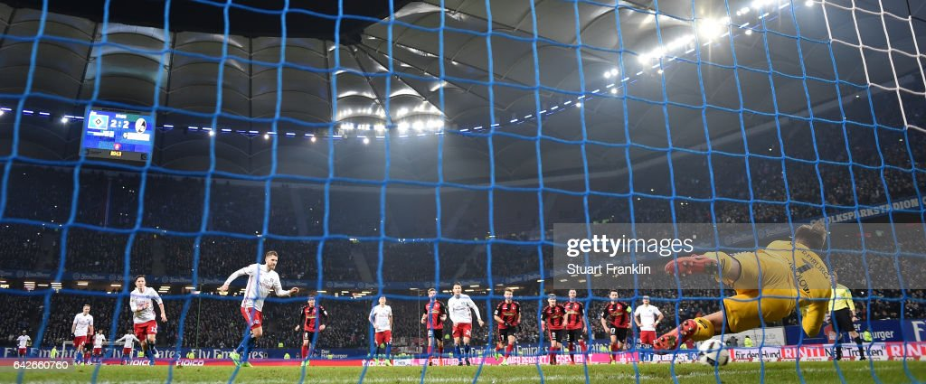 Alexander Schwolow of Freiburg saves the penalty kick by Aaron Hunt of Hamburg during the Bundesliga match between Hamburger SV and SC Freiburg at Volksparkstadion on February 18, 2017 in Hamburg, Germany.