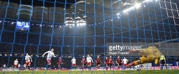 Alexander Schwolow of Freiburg saves the penalty kick by Aaron Hunt of Hamburg during the Bundesliga match between Hamburger SV and SC Freiburg at...