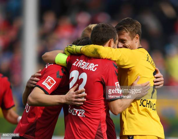 Alexander Schwolow of SC Freiburg and team mates celebrate victory after the Bundesliga match between SportClub Freiburg and TSG 1899 Hoffenheim at...