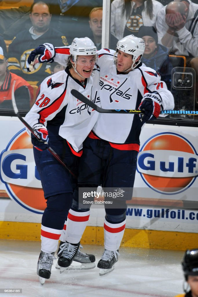 Alexander Semin and Brooks Laich of the Washington Capitals celebrate a goal against the Boston Bruins at the TD Garden on February 2 2010 in Boston...