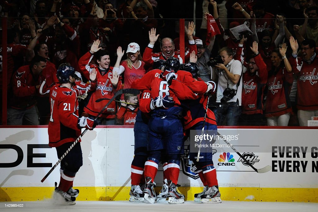 <a gi-track='captionPersonalityLinkClicked' href=/galleries/search?phrase=Alexander+Semin&family=editorial&specificpeople=206654 ng-click='$event.stopPropagation()'>Alexander Semin</a> #28 celebrates with Alex Ovechkin #8, <a gi-track='captionPersonalityLinkClicked' href=/galleries/search?phrase=Brooks+Laich&family=editorial&specificpeople=554432 ng-click='$event.stopPropagation()'>Brooks Laich</a> #21, and Nicklas Backstrom #19 of the Washington Capitals after scoring a goal against the Boston Bruins in the first period of Game Three of the Eastern Conference Quarterfinals during the 2012 NHL Stanley Cup Playoffs at Verizon Center on April 16, 2012 in Washington, DC.
