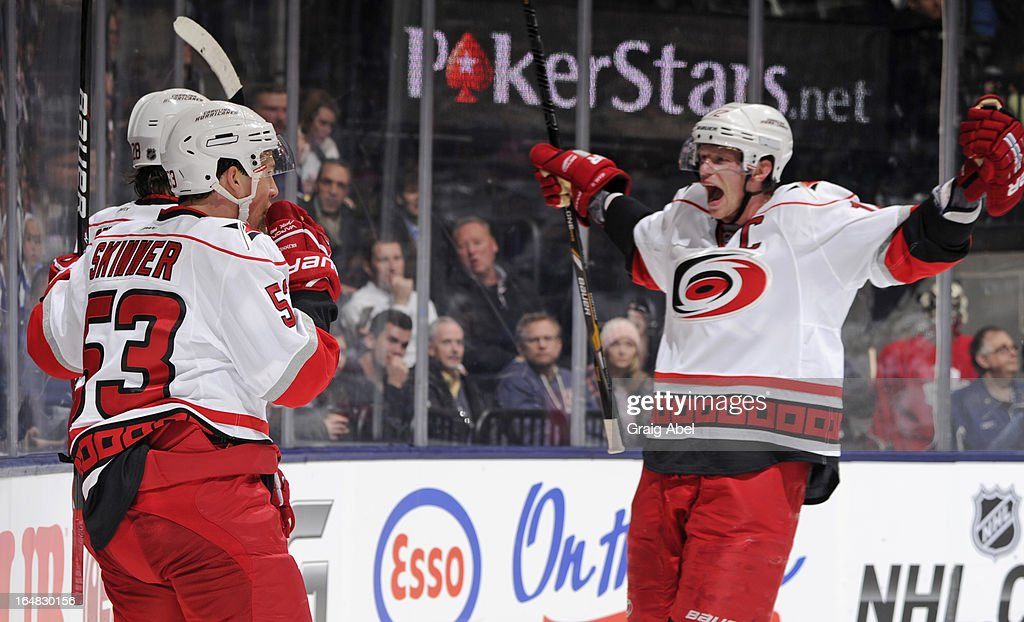 Alexander Semin #28, Jeff Skinner #53 and Eric Staal #12 of the Carolina Hurricanes celebrate a second period goal during NHL game action against the Toronto Maple Leafs March 28, 2013 at the Air Canada Centre in Toronto, Ontario, Canada.