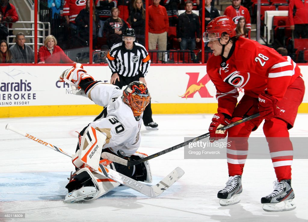 Alexander Semin of the Carolina Hurricanes attempts a backhand a shot past Viktor Fasth of the Anaheim Ducks during their NHL game at PNC Arena on...