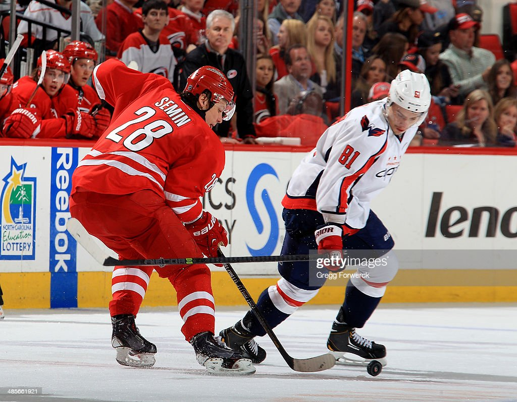 <a gi-track='captionPersonalityLinkClicked' href=/galleries/search?phrase=Alexander+Semin&family=editorial&specificpeople=206654 ng-click='$event.stopPropagation()'>Alexander Semin</a> #28 of the Carolina Hurricanes battles for a loose puck against <a gi-track='captionPersonalityLinkClicked' href=/galleries/search?phrase=Dmitry+Orlov&family=editorial&specificpeople=4782302 ng-click='$event.stopPropagation()'>Dmitry Orlov</a> #81 of the Washington Capitals during their NHL game at PNC Arena on April 10, 2014 in Raleigh, North Carolina.