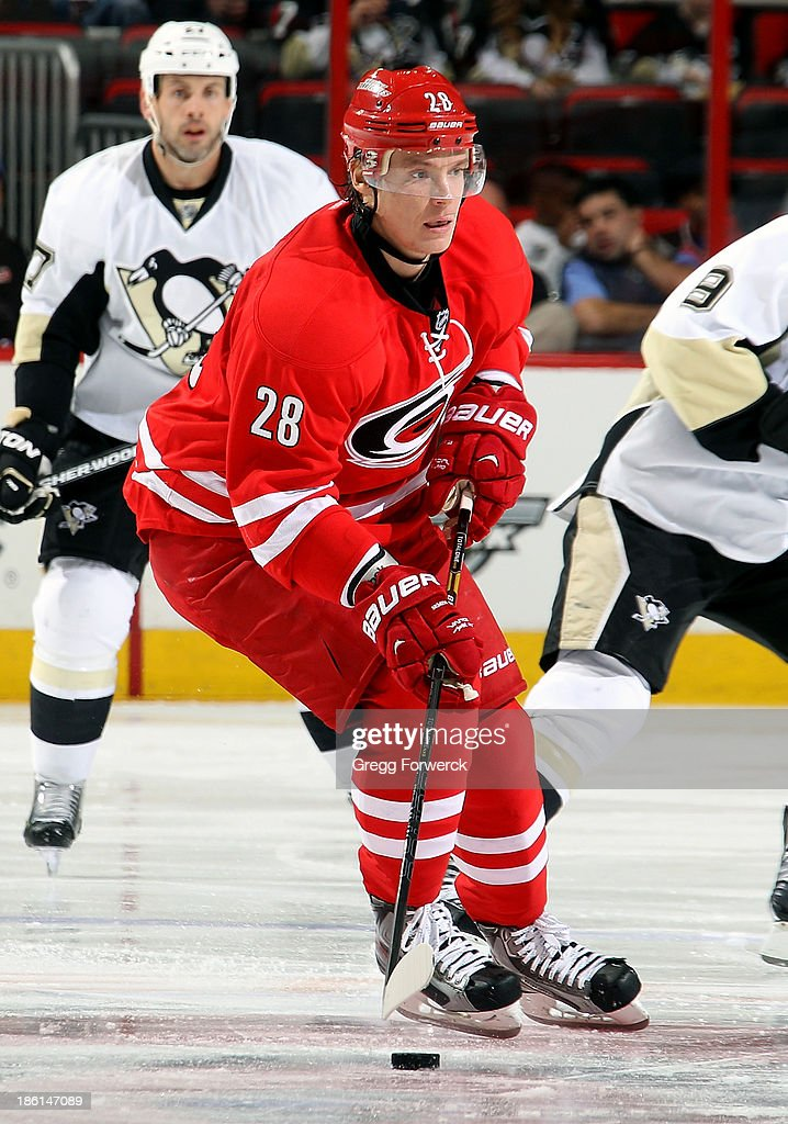 Alexander Semin #28 of the Carolina Hurricanes carries the puck through the neutral zone during an NHL game against the Pittsburgh Penguins at PNC Arena on October 28, 2013 in Raleigh, North Carolina.