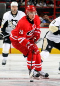 Alexander Semin of the Carolina Hurricanes carries the puck through the neutral zone during an NHL game against the Pittsburgh Penguins at PNC Arena...