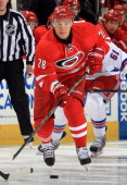 Alexander Semin of the Carolina Hurricanes carries the puck through the neutral zone during an NHL game against the New York Rangers at PNC Arena on...