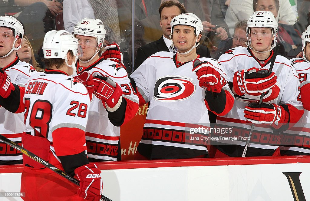 Alexander Semin #28 of the Carolina Hurricanes celebrates his game tying third period goal with team mates Jussi Jokinen #36, Tim Wallace #29 and Drayson Bowman #21, during an NHL game at Scotiabank Place on February 7, 2013 in Ottawa, Ontario, Canada.