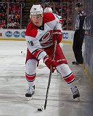 Alexander Semin of the Carolina Hurricanes controls the puck during a NHL game against the Detroit Red Wings on April 7 2015 at Joe Louis Arena in...