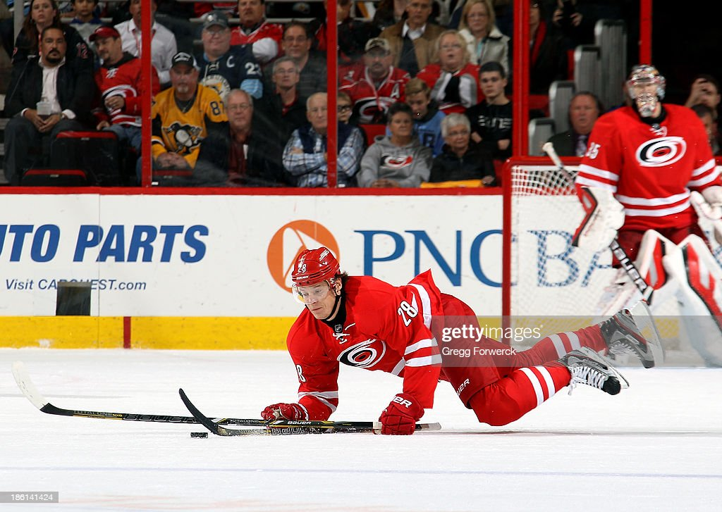<a gi-track='captionPersonalityLinkClicked' href=/galleries/search?phrase=Alexander+Semin&family=editorial&specificpeople=206654 ng-click='$event.stopPropagation()'>Alexander Semin</a> #28 of the Carolina Hurricanes falls to the ice after being tripped by Brandon Sutter of the Pittsburgh Penguins during their NHL game at PNC Arena on October 28, 2013 in Raleigh, North Carolina.