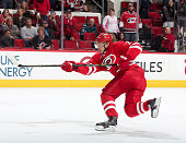 Alexander Semin of the Carolina Hurricanes fires the puck during their NHL game against the Buffalo Sabres at PNC Arena on October 14 2014 in Raleigh...
