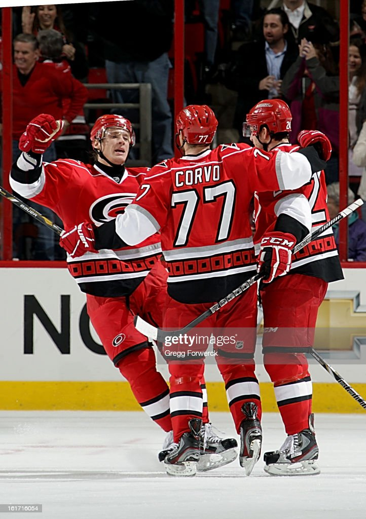 Alexander Semin #28 of the Carolina Hurricanes joins Bobby Sanguinetti #24 in celebrating a goal scored by Joe Corvo #77 against the Toronto Maple Leafs during their NHL game at PNC Arena on February 14, 2013 in Raleigh, North Carolina.