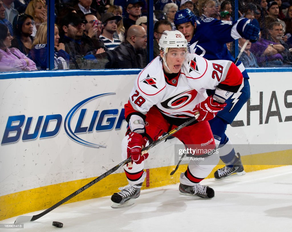 Alexander Semin #28 of the Carolina Hurricanes moves the puck during the second period of the game against the Tampa Bay Lightning at the Tampa Bay Times Forum on March 16, 2013 in Tampa, Florida.