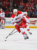 Alexander Semin of the Carolina Hurricanes plays the puck during the game against the New Jersey Devils at the Prudential Center on February 21 2015...
