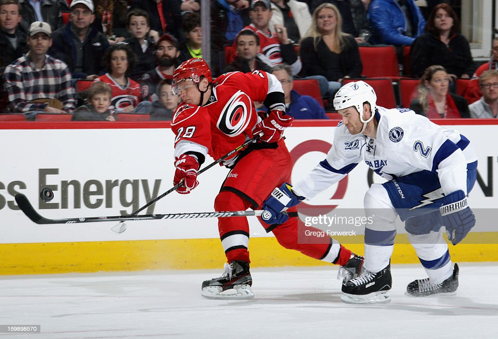 Alexander Semin #28 of the Carolina Hurricanes rips a shot past the stick of defenseman Eric Brewer #2 of the Tampa Bay Lightning during an NHL game on January 22, 2013 at PNC Arena in Raleigh, North Carolina.