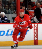Alexander Semin of the Carolina Hurricanes skates for position on the ice against the Winnipeg Jets during an NHL game at PNC Arena on February 4...