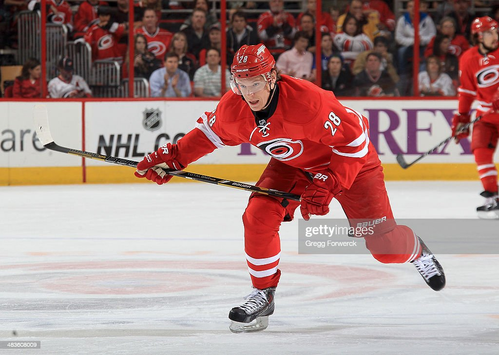 Alexander Semin of the Carolina Hurricanes skates for position on the ice during their NHL game against the New Jersey Devils at PNC Arena on April 5...