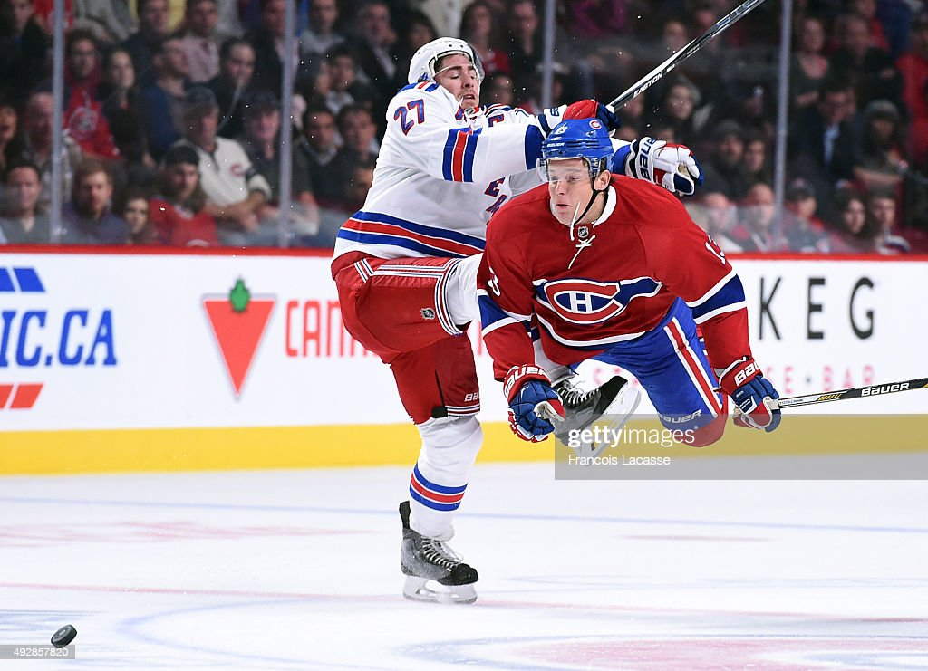 Alexander Semin of the Montreal Canadiens body checks Ryan McDonagh of the New York Rangers in the NHL game at the Bell Centre on October 15 2015 in...