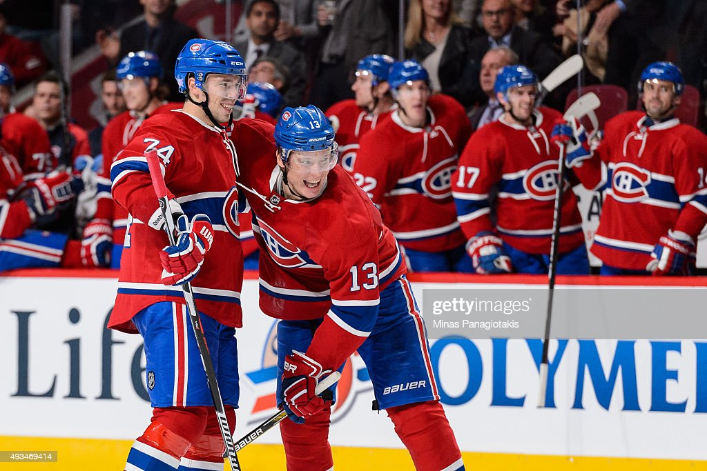 Alexander Semin of the Montreal Canadiens celebrates his second period goal and his first as a Canadien with teammate Alexei Emelin during the NHL...