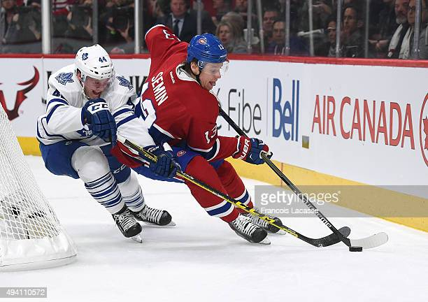 Alexander Semin of the Montreal Canadiens controls the puck while being challenged by Morgan Rielly of the Toronto Maple Leafs in the NHL game at the...