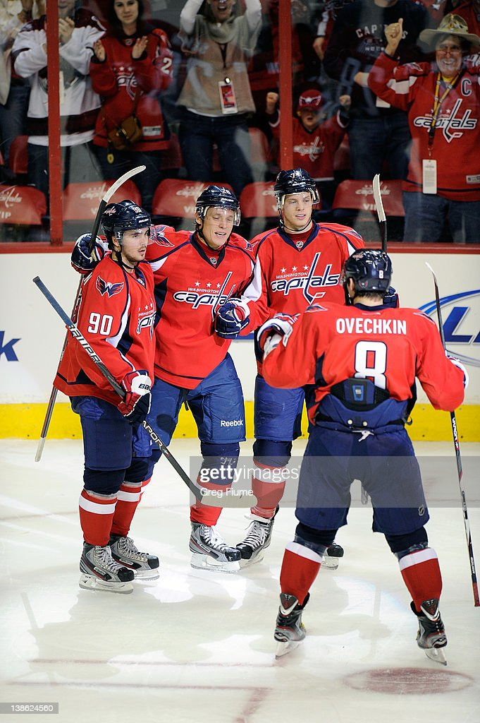 <a gi-track='captionPersonalityLinkClicked' href=/galleries/search?phrase=Alexander+Semin&family=editorial&specificpeople=206654 ng-click='$event.stopPropagation()'>Alexander Semin</a> #28 of the Washington Capitals celebrates with teammates after scoring in the third period against the Winnipeg Jets at the Verizon Center on February 9, 2012 in Washington, DC.