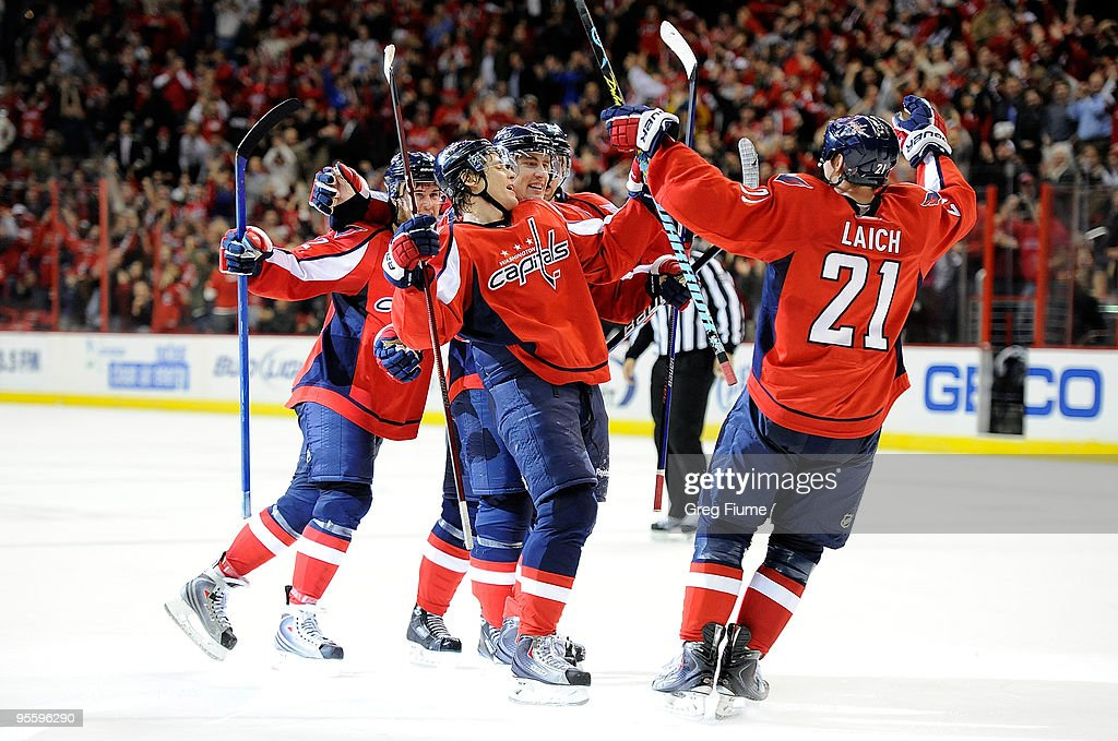 Alexander Semin of the Washington Capitals celebrates with teammates after scoring in the third period against the Montreal Canadiens at the Verizon...