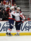Alexander Semin of the Washington Capitals hugs teammate Nicklas Backstrom after Backstrom scored their second goal against the Chicago Blackhawks on...