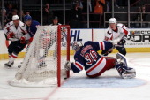 Alexander Semin of the Washington Capitals scores a goal in the third period against goalie Henrik Lundqvist of the New York Rangers in Game Four of...