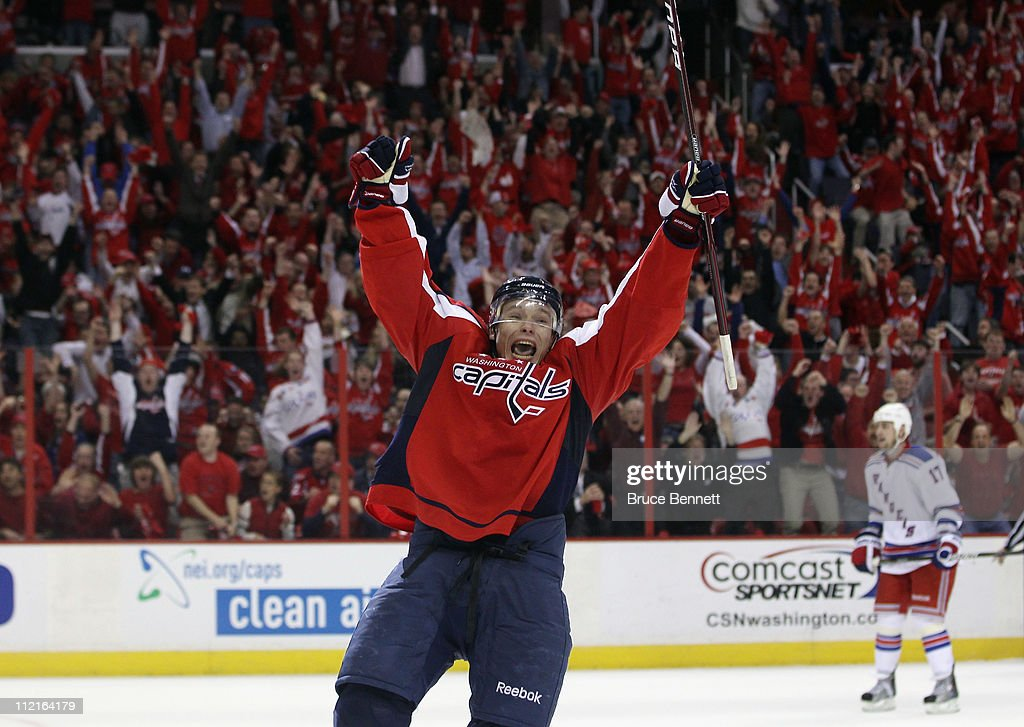 Alexander Semin of the Washington Capitals scores the game winning goal at 1824 of overtime against the New York Rangers in Game One of the Eastern...