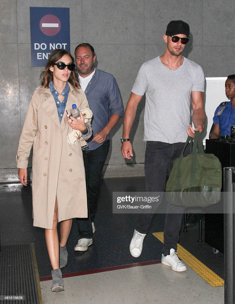 Alexander Skarsgard and Alexa Chung are seen at LAX on July 21 2015 in Los Angeles California