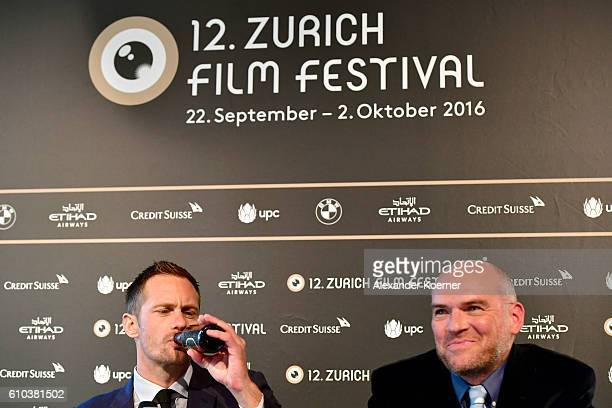 Alexander Skarsgard drinks beer next to John Michael McDonagh at the 'War On Everyone' Press Conference during the 12th Zurich Film Festival on...