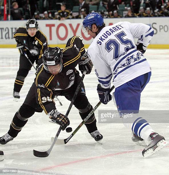 Alexander Skugarev of Russia's Dynamo Moscow fights for a pick with Michal Bros OF Finland's Karpat Oulu during the final of the European Champions...