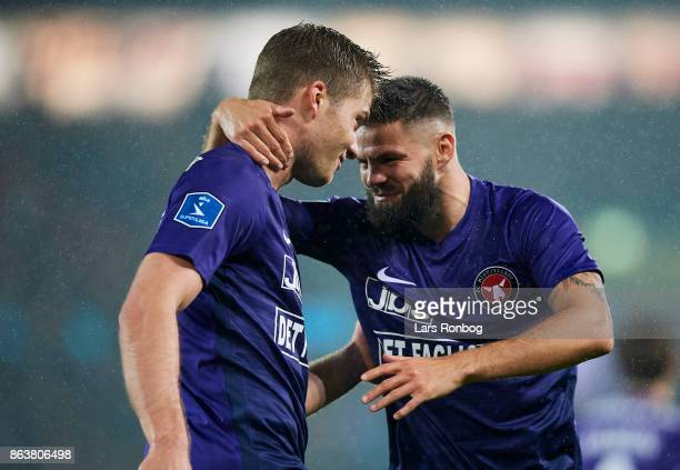 Alexander Sorloth and Marc Dal Hende of FC Midtjylland celebrate after scoring their first goal during the Danish Alka Superliga match between FC...