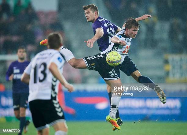 Alexander Sorloth of FC Midtjylland and Alexander Ludwig of AC Horsens compete for the ball during the Danish Alka Superliga match between FC...