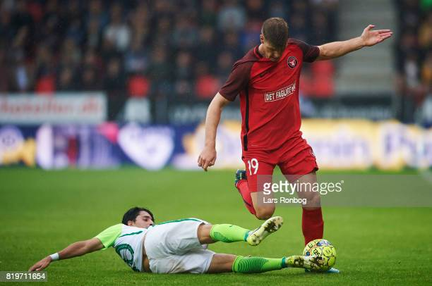 Alexander Sorloth of FC Midtjylland and Rui Pedro of Ferencvarosi TC compete for the ball during the UEFA Europa League Qualification match between...
