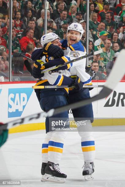 Alexander Steen and Colton Parayko of the St Louis Blues celebrate after scoring a goal against the Minnesota Wild in Game Five of the Western...