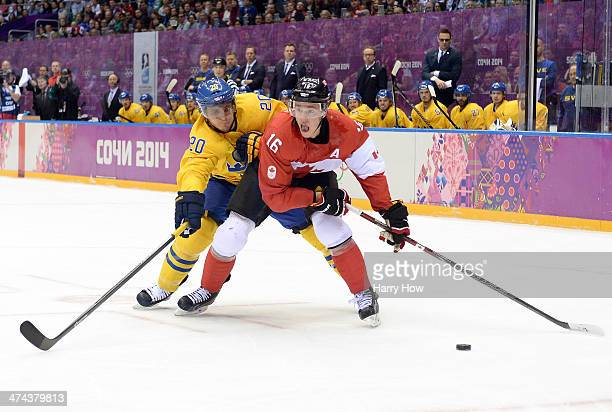 Alexander Steen of Sweden challenges Jonathan Toews of Canada for the puck during the Men's Ice Hockey Gold Medal match on Day 16 of the 2014 Sochi...