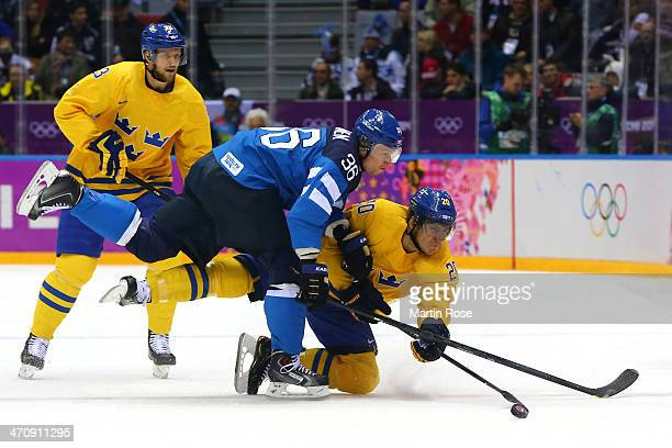 Alexander Steen of Sweden tries to shoot against Jussi Jokinen of Finland in the first period during the Men's Ice Hockey Semifinal Playoff on Day 14...