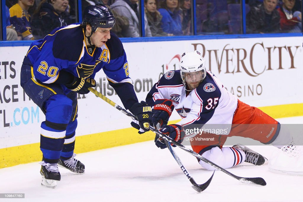 <a gi-track='captionPersonalityLinkClicked' href=/galleries/search?phrase=Alexander+Steen&family=editorial&specificpeople=600136 ng-click='$event.stopPropagation()'>Alexander Steen</a> #20 of the St. Louis Blues and <a gi-track='captionPersonalityLinkClicked' href=/galleries/search?phrase=Jan+Hejda&family=editorial&specificpeople=624333 ng-click='$event.stopPropagation()'>Jan Hejda</a> #35 of the Columbus Blue Jackets fight for control of the puck at the Scottrade Center on March 7, 2011 in St. Louis, Missouri. The Blues beat the Bluejackets 5-4 in a shoot out.