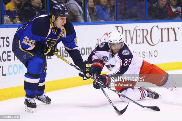 Alexander Steen of the St Louis Blues and Jan Hejda of the Columbus Blue Jackets fight for control of the puck at the Scottrade Center on March 7...