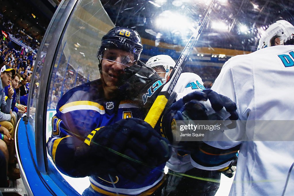 Alexander Steen of the St Louis Blues and Tomas Hertl of the San Jose Sharks battle against the glass during the second period in Game Five of the...